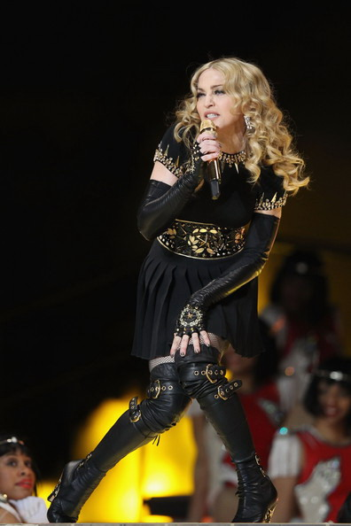 Madonna makes a big splash during her 2004 musical tour when she wears Miu Miu's black leather and gold buckled boots (created exclusively for her) on stage
