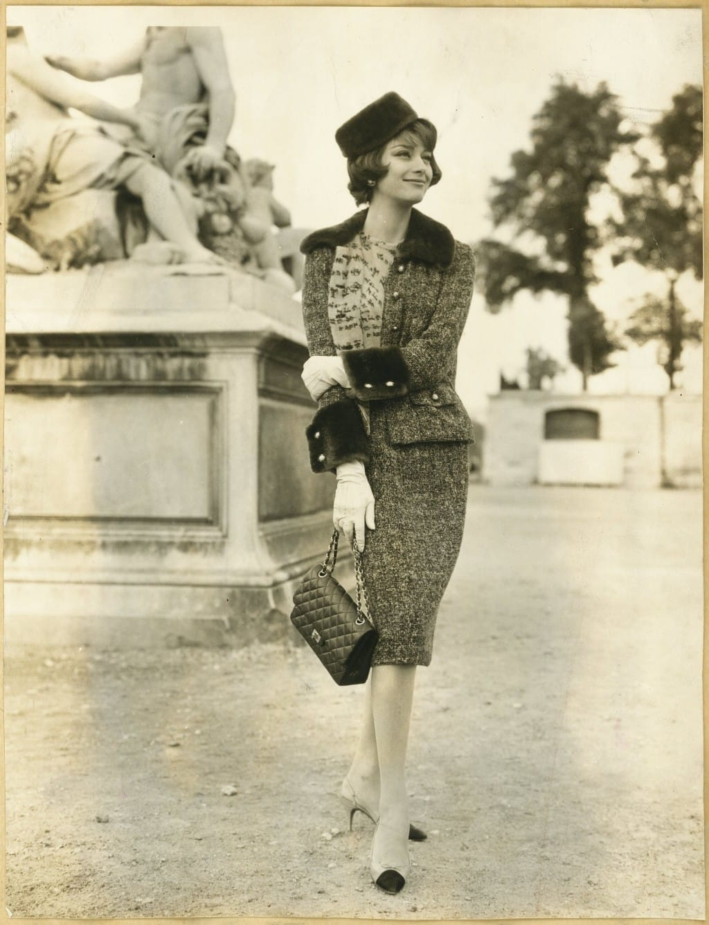 Marie Helene Arnaud carrying the first Chanel 2.55 bag